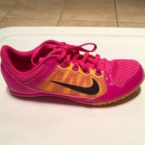 Nike bright pink racing shoes. Nike bright pink racing shoes. $60 $85. Vintage  WNBA Nike Sheryl Swoopes Basketball shoes